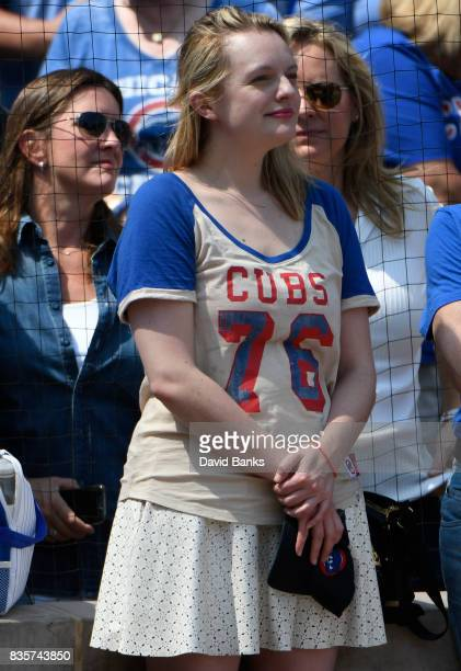 Actress Elisabeth Moss stands for the national anthem before the game between the Chicago Cubs and the Toronto Blue Jays on August 18 2017 at Wrigley...