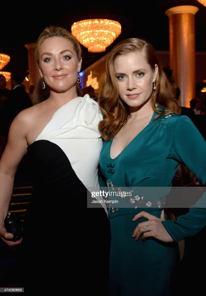 Actress Elisabeth Rohm (L) and honoree Amy Adams attend the 16th Costume Designers Guild Awards with presenting sponsor Lacoste at The Beverly Hilton Hotel on February 22, 2014 in Beverly Hills, California.