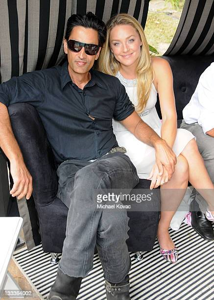 Actress Elisabeth Rohm and husband Ron Wooster appear at the 5th Annual Miss Malibu Pageant at a Private Residence on August 23 2009 in Malibu...