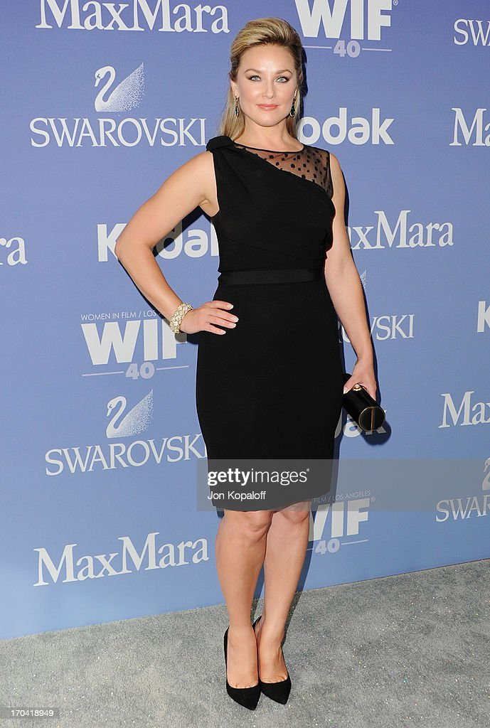 Actress <a gi-track='captionPersonalityLinkClicked' href=/galleries/search?phrase=Elisabeth+Rohm&family=editorial&specificpeople=203139 ng-click='$event.stopPropagation()'>Elisabeth Rohm</a> arrives at the 2013 Women In Film's Crystal + Lucy Awards at The Beverly Hilton Hotel on June 12, 2013 in Beverly Hills, California.
