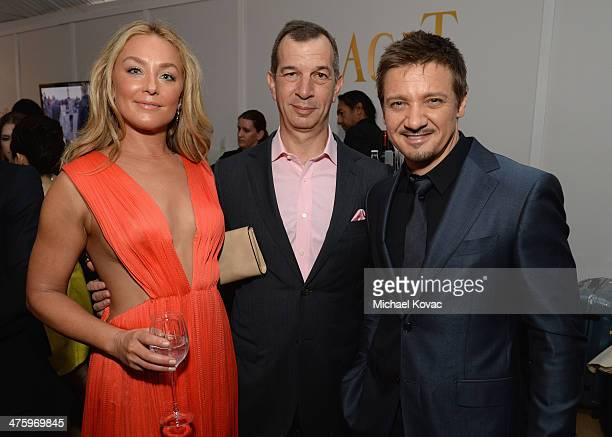 Actress Elisabeth Rohm CEO of Piaget Philippe LeopoldMetzger and actor Jeremy Renner pose in the Piaget Lounge during the 2014 Film Independent...