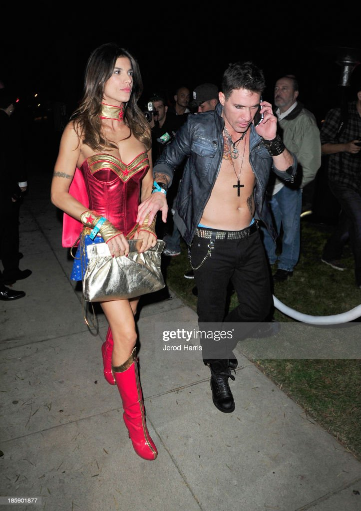 Actress <a gi-track='captionPersonalityLinkClicked' href=/galleries/search?phrase=Elisabetta+Canalis&family=editorial&specificpeople=2292377 ng-click='$event.stopPropagation()'>Elisabetta Canalis</a> (L) attends the Casamigos Halloween Party at the home of Mike Meldman on October 25, 2013 in Beverly Hills, California.