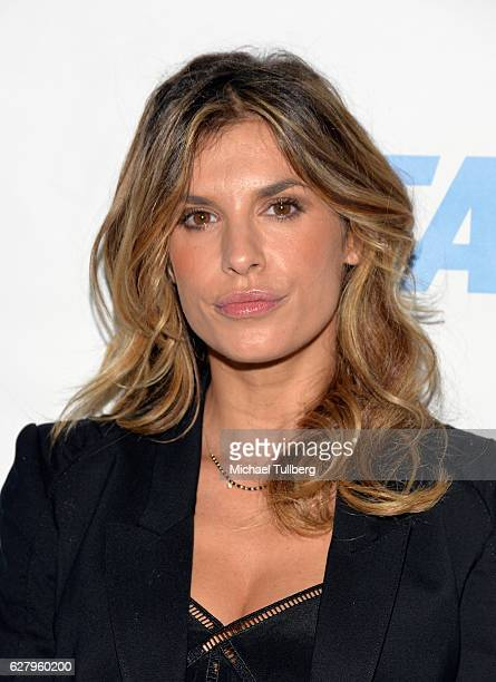 Actress Elisabetta Canalis attends the unveiling of Jhene Aiko's 'Rather Go Naked Than Wear Fur' ad at the opening night of PETA's 'Naked Ambition...