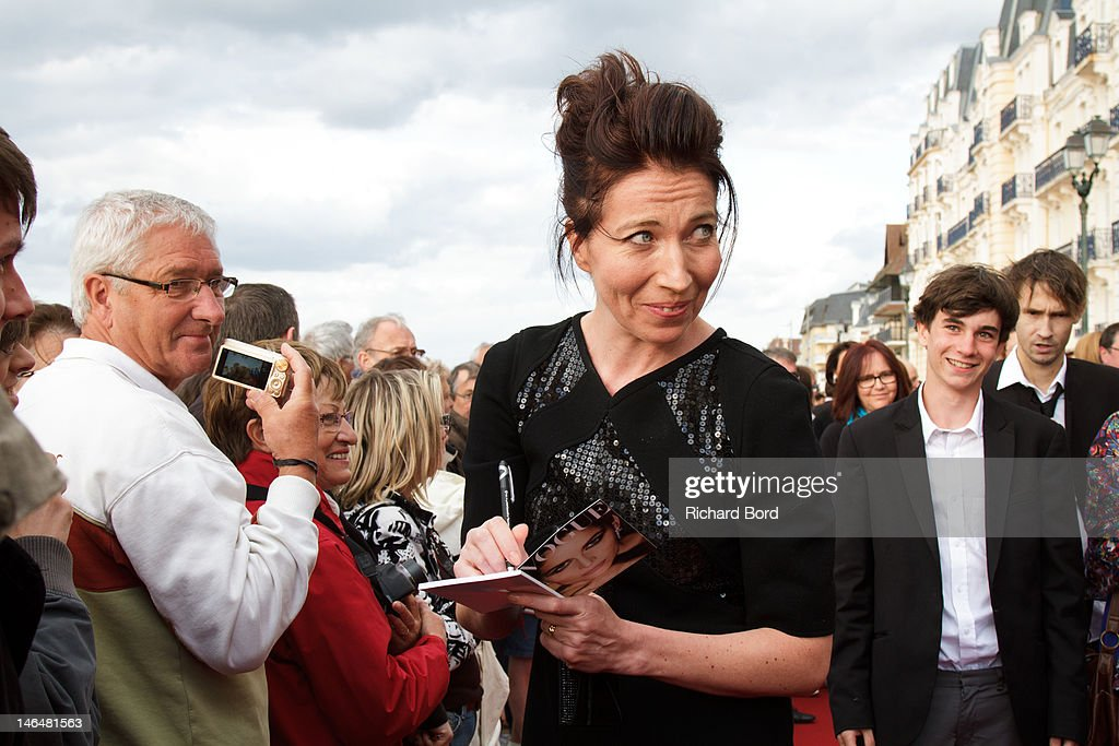 Actress Elise Larnicol signs an autograph as she attends the 26th Cabourg Romantic Film Festival on June 16, 2012 in Cabourg, France.