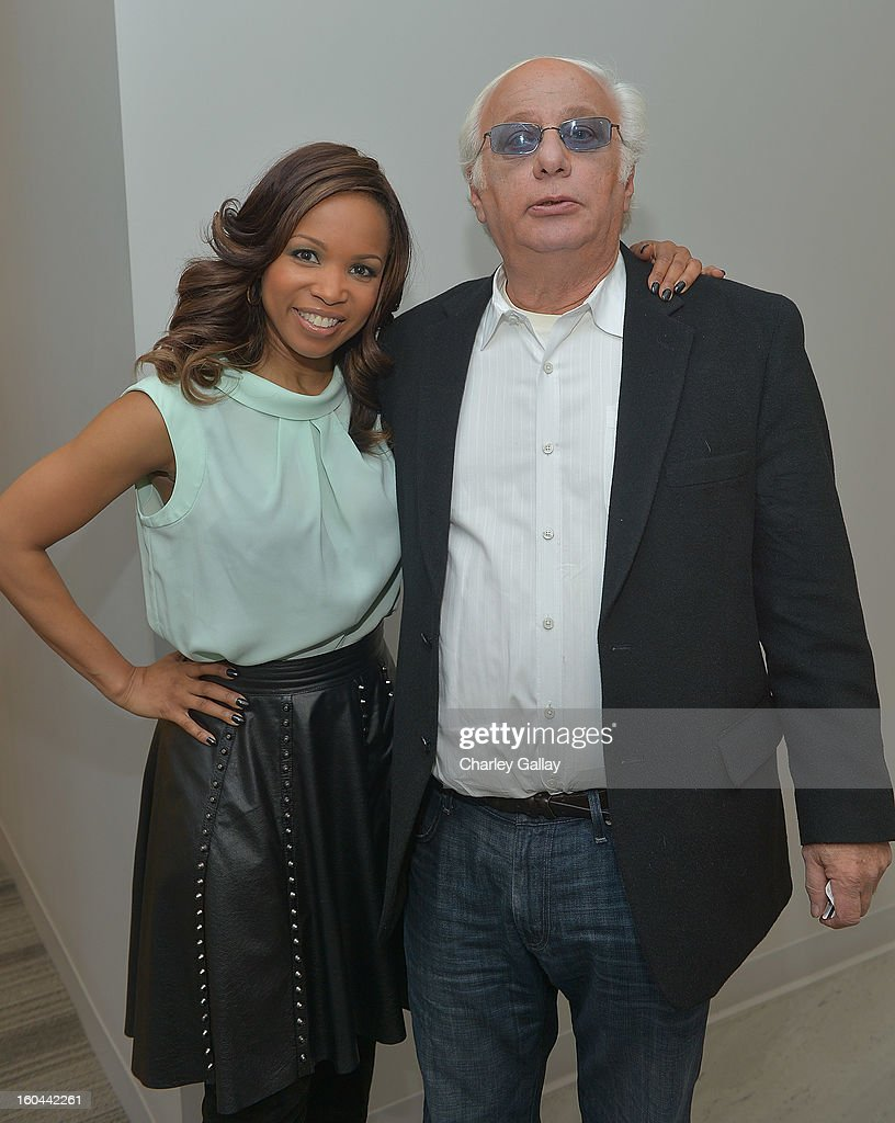 Actress <a gi-track='captionPersonalityLinkClicked' href=/galleries/search?phrase=Elise+Neal&family=editorial&specificpeople=204780 ng-click='$event.stopPropagation()'>Elise Neal</a> (L) and Executive Producer for 'Belle's' Ed. Weinberger attend the taping of TV One's 'Washington Watch With Roland Martin' Hollywood Special at KCET Studios on January 31, 2013 in Hollywood, California.