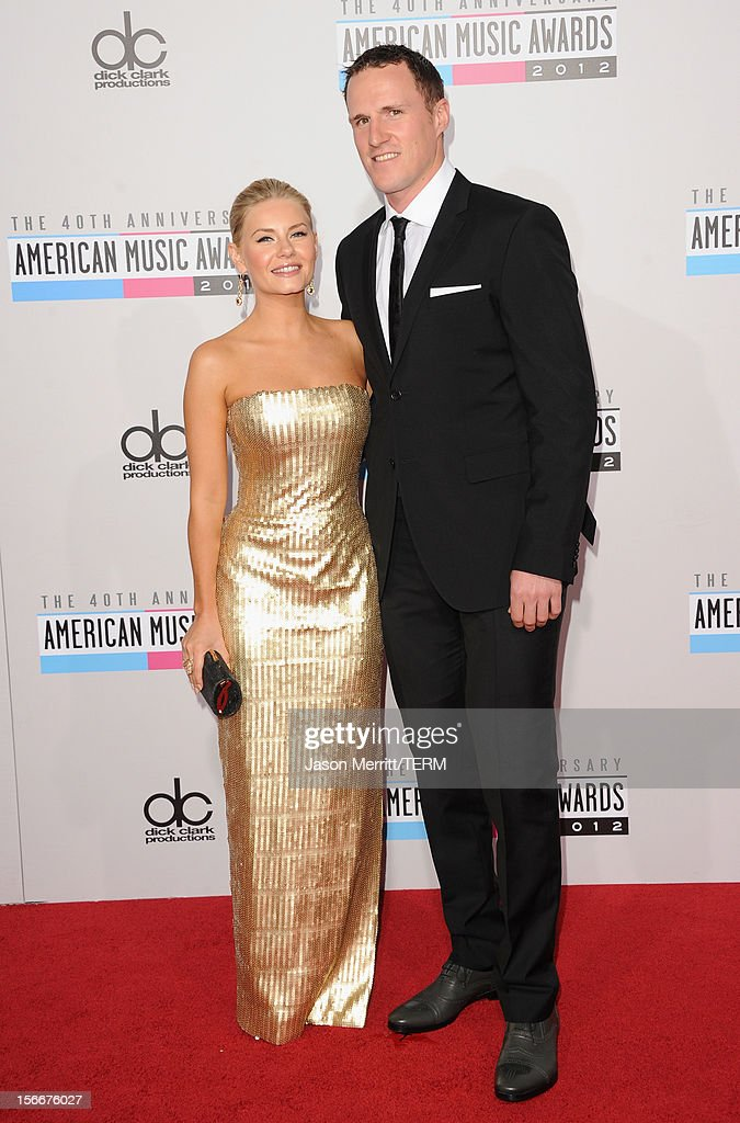 Actress Elisha Cuthbert and athlete Dion Phaneuf attend the 40th American Music Awards held at Nokia Theatre L.A. Live on November 18, 2012 in Los Angeles, California.