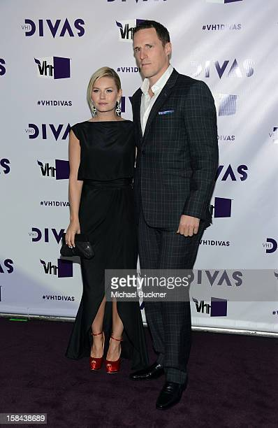 Actress Elisha Cuthbert and NHL player Dion Phaneuf attend 'VH1 Divas' 2012 at The Shrine Auditorium on December 16 2012 in Los Angeles California