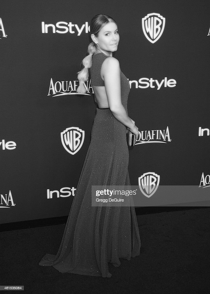 Actress Elisha Cuthbert arrives at the 16th Annual Warner Bros. And InStyle Post-Golden Globe Party at The Beverly Hilton Hotel on January 11, 2015 in Beverly Hills, California.