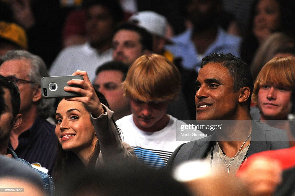 Actress Eliza Dushku and former NBA player Rick Fox look on during a game between the Dallas Mavericks and the Los Angeles Lakers at Staples Center on April 2, 2013 in Los Angeles, California.