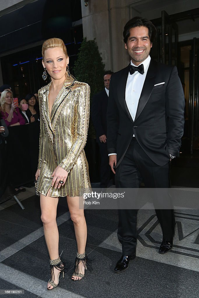 Actress <a gi-track='captionPersonalityLinkClicked' href=/galleries/search?phrase=Elizabeth+Banks&family=editorial&specificpeople=202475 ng-click='$event.stopPropagation()'>Elizabeth Banks</a> and Designer Brian Atwood depart the Mark Hotel for the 'PUNK: Chaos To Couture' Costume Institute Gala at the Metropolitan Museum of Art on May 6, 2013 in New York City.