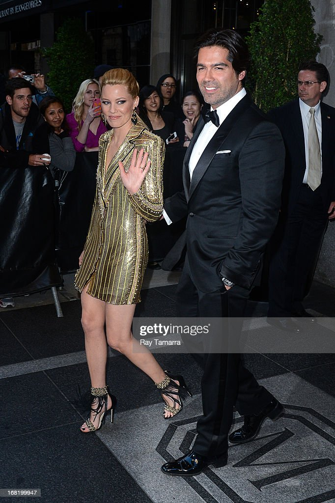 Actress <a gi-track='captionPersonalityLinkClicked' href=/galleries/search?phrase=Elizabeth+Banks&family=editorial&specificpeople=202475 ng-click='$event.stopPropagation()'>Elizabeth Banks</a> and designer Brian Atwood leaves their Upper East Side hotel on May 6, 2013 in New York City.