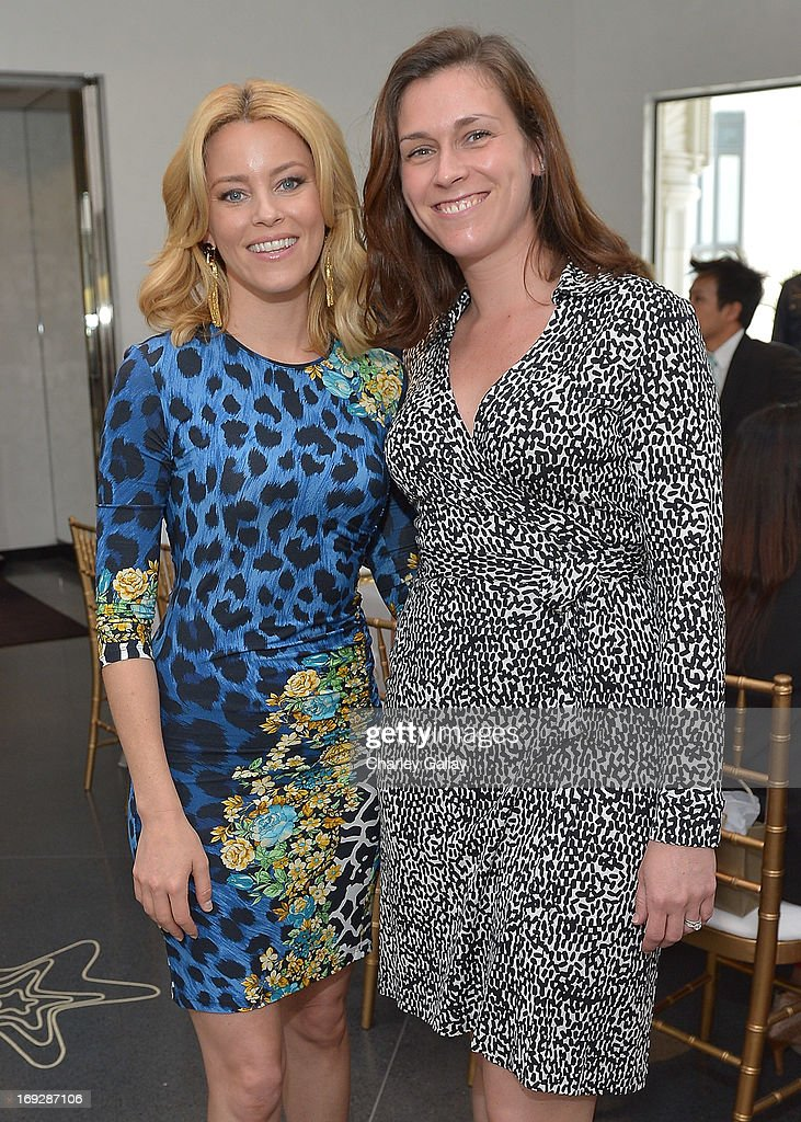 Actress Elizabeth Banks (L) and Vital Voices' Jennifer Smith attend Versace, Vanity Fair, And Elizabeth Banks Luncheon Benefitting Vital Voices Global Partnership at Versace on May 22, 2013 in Beverly Hills, California.