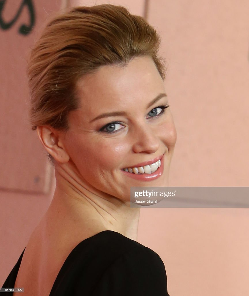 Actress <a gi-track='captionPersonalityLinkClicked' href=/galleries/search?phrase=Elizabeth+Banks&family=editorial&specificpeople=202475 ng-click='$event.stopPropagation()'>Elizabeth Banks</a> arrives at the Hollywood Reporter's 21st annual women in entertainment breakfast at The Beverly Hills Hotel on December 5, 2012 in Beverly Hills, California.