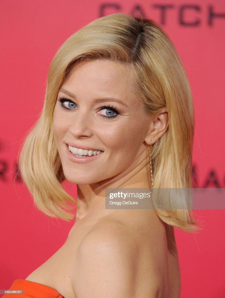 Actress <a gi-track='captionPersonalityLinkClicked' href=/galleries/search?phrase=Elizabeth+Banks&family=editorial&specificpeople=202475 ng-click='$event.stopPropagation()'>Elizabeth Banks</a> arrives at the Los Angeles premiere of 'The Hunger Games: Catching Fire' at Nokia Theatre L.A. Live on November 18, 2013 in Los Angeles, California.