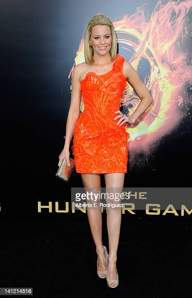 Actress Elizabeth Banks arrives to the premiere of Lionsgate's 'The Hunger Games' at Nokia Theatre LA Live on March 12 2012 in Los Angeles California