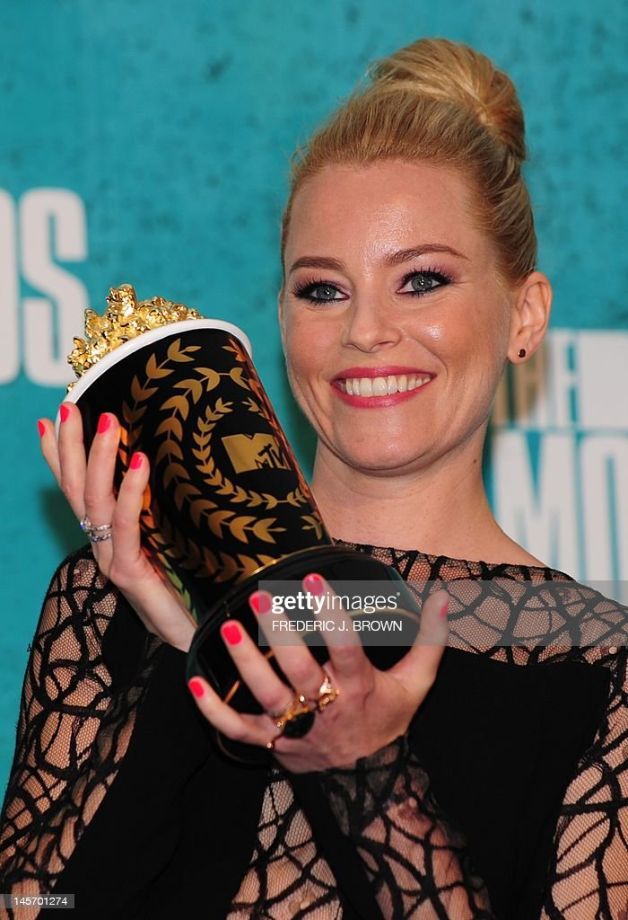 Actress Elizabeth Banks holds her award for 'Best On-Screen Transformation' for her role in 'The Hunger Games,' in the press room at the MTV Movie Awards at Universal Studios, in Los Angeles, California, on June 3, 2012.