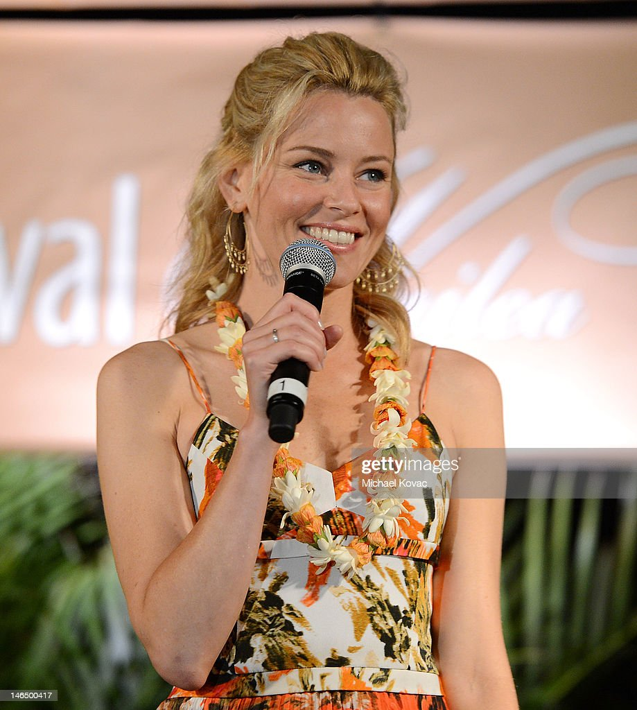 Actress <a gi-track='captionPersonalityLinkClicked' href=/galleries/search?phrase=Elizabeth+Banks&family=editorial&specificpeople=202475 ng-click='$event.stopPropagation()'>Elizabeth Banks</a> is honored with the 2012 Navigator Award at the 2012 Maui Film Festival at the Celestial Cinema on June 17, 2012 in Wailea, Hawaii.