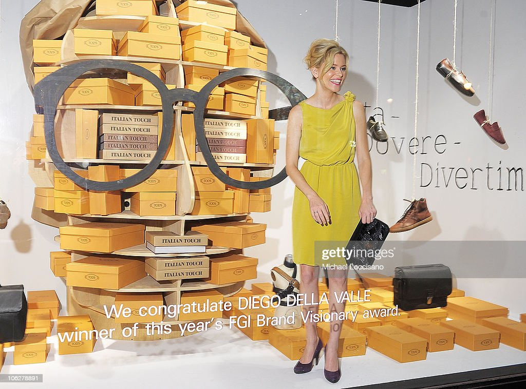 Actress Elizabeth Banks poses in the store window during Diego Della Valle's Brand Visionary Award celebrated by Barneys at Barneys New York on...