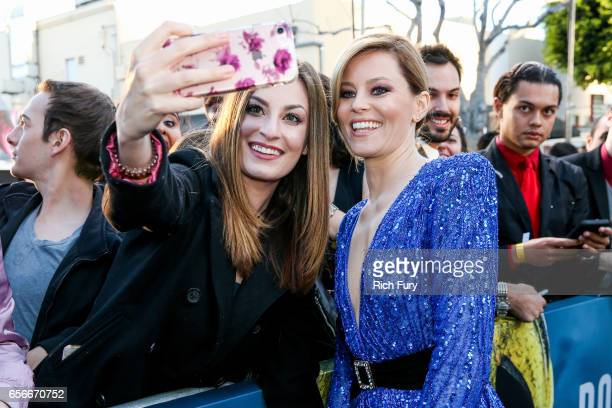 Actress Elizabeth Banks poses with fans at the premiere of Lionsgate's 'Power Rangers' at the Westwood Village Theatre on March 22 2017 in Westwood...
