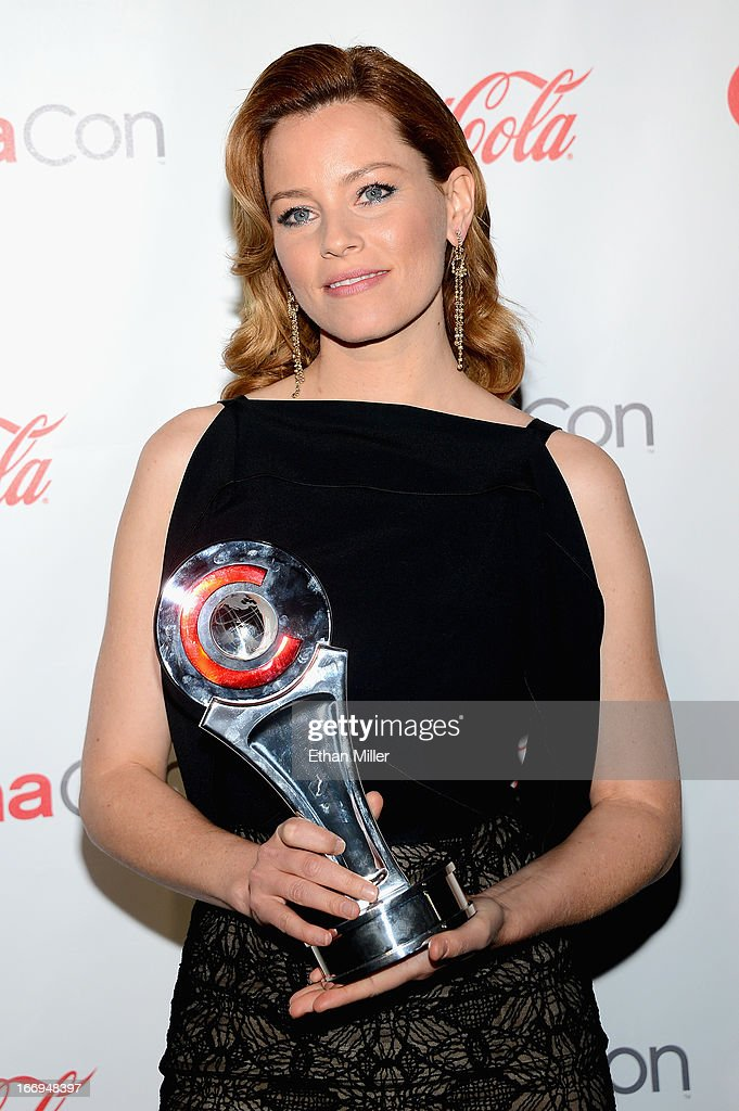 Actress <a gi-track='captionPersonalityLinkClicked' href=/galleries/search?phrase=Elizabeth+Banks&family=editorial&specificpeople=202475 ng-click='$event.stopPropagation()'>Elizabeth Banks</a>, recipient of the Award of Excellence in Acting, arrives at the CinemaCon awards ceremony at the Pure Nightclub at Caesars Palace during CinemaCon, the official convention of the National Association of Theatre Owners, on April 18, 2013 in Las Vegas, Nevada.