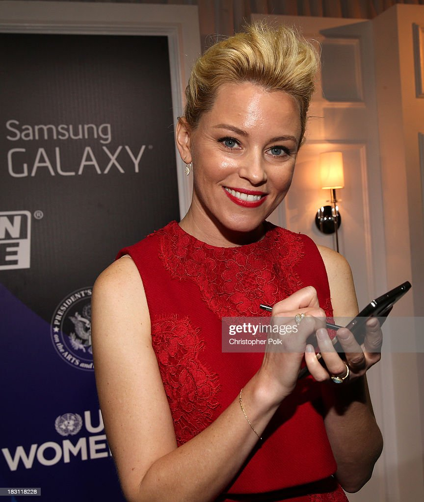 Actress <a gi-track='captionPersonalityLinkClicked' href=/galleries/search?phrase=Elizabeth+Banks&family=editorial&specificpeople=202475 ng-click='$event.stopPropagation()'>Elizabeth Banks</a> signs photo for Samsung's Signatures for Good on the Samsung Galaxy Note 3 at Variety's 5th Annual Power of Women event presented by Lifetime at the Beverly Wilshire Four Seasons Hotel on October 4, 2013 in Beverly Hills, California.