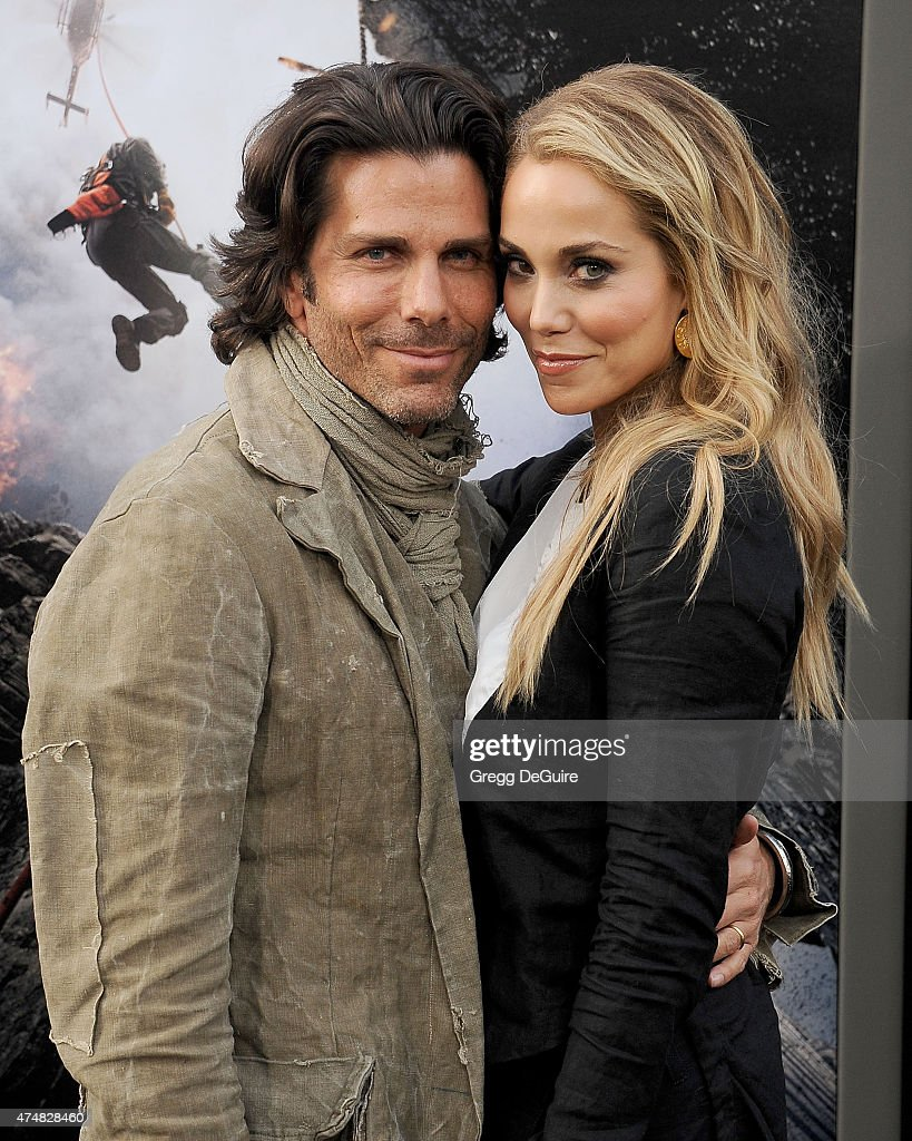 Actress Elizabeth Berkley and husband Greg Lauren arrive at the Los Angeles premiere of 'San Andreas' at TCL Chinese Theatre IMAX on May 26 2015 in...