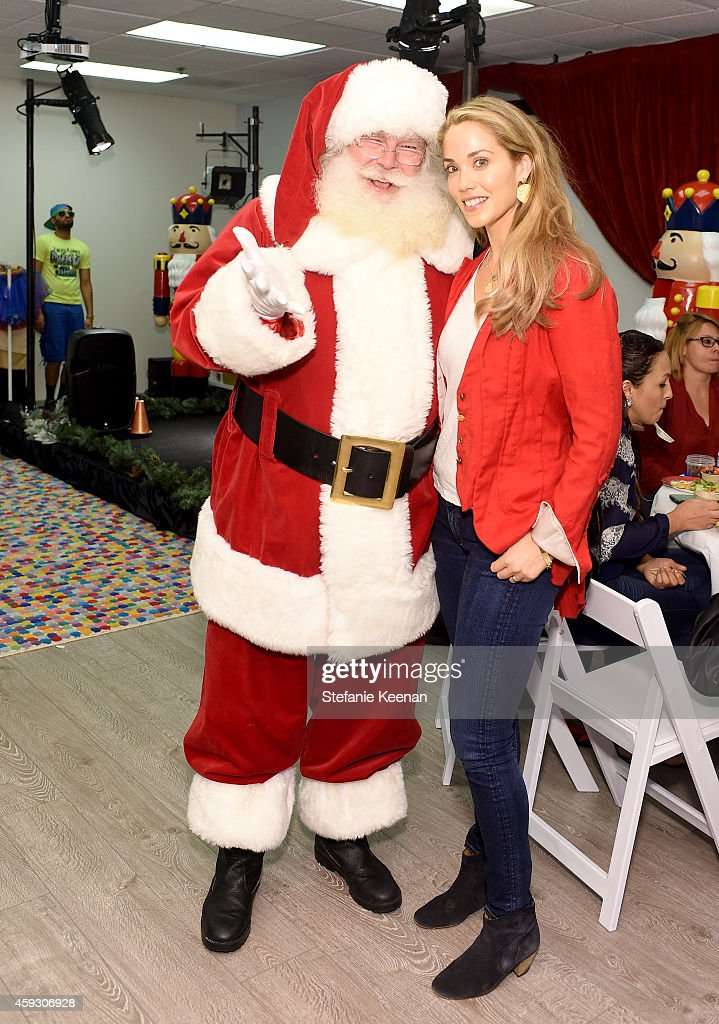 Actress Elizabeth Berkley attend the Baby2Baby Nutcracker Party, Presented By Tiny Prints on November 20, 2014 in Los Angeles, California.