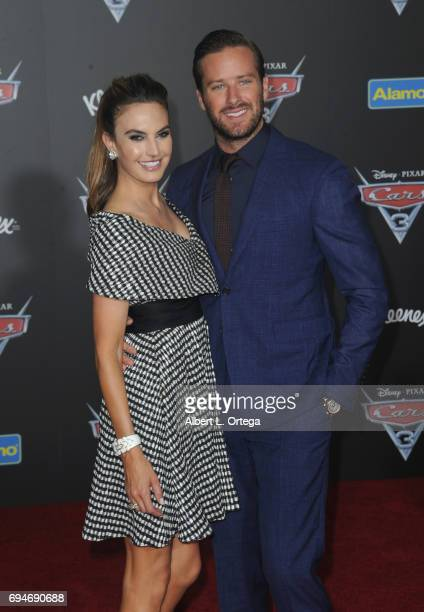Actress Elizabeth Chambers and actor Armie Hammer arrive for the Premiere Of Disney And Pixar's 'Cars 3' held at Anaheim Convention Center on June 10...
