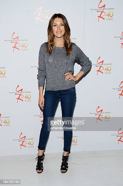 Actress Elizabeth Hendrickson attends the 'The Young The Restless' 40th anniversary cakecutting ceremony at CBS Television City on March 26 2013 in...
