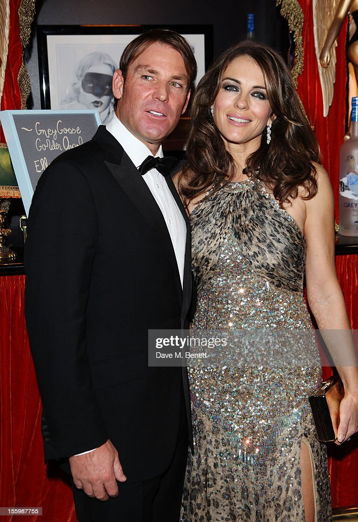 Actress Elizabeth Hurley and ex-cricketer Shane Warne arrive at the Grey Goose Winter Ball at Battersea Power Station on November 10, 2012 in London, England.