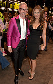 Actress Elizabeth Hurley and shoe designer Patrick Cox attend the DSQUARED2 celebration of London Flagship Opening on April 21 2015 in London England