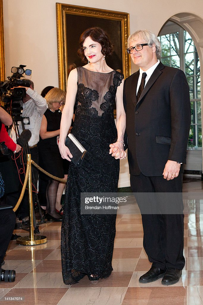 Actress Elizabeth Lee McGovern (L) and Simon Adams Curtis arrive for a State Dinner in honor of British Prime Minister David Cameron at the White House on March 14, 2012 in Washington, DC. Cameron is on a three day official visit to Washington.