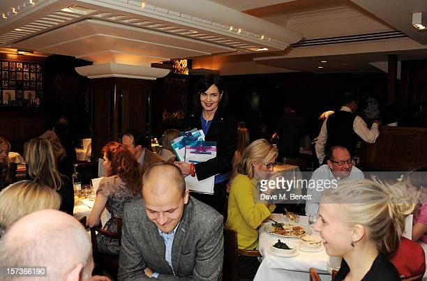 Actress Elizabeth McGovern working as a hostess attends One Night Only at The Ivy featuring 30 stage and screen actors working as staff during dinner...