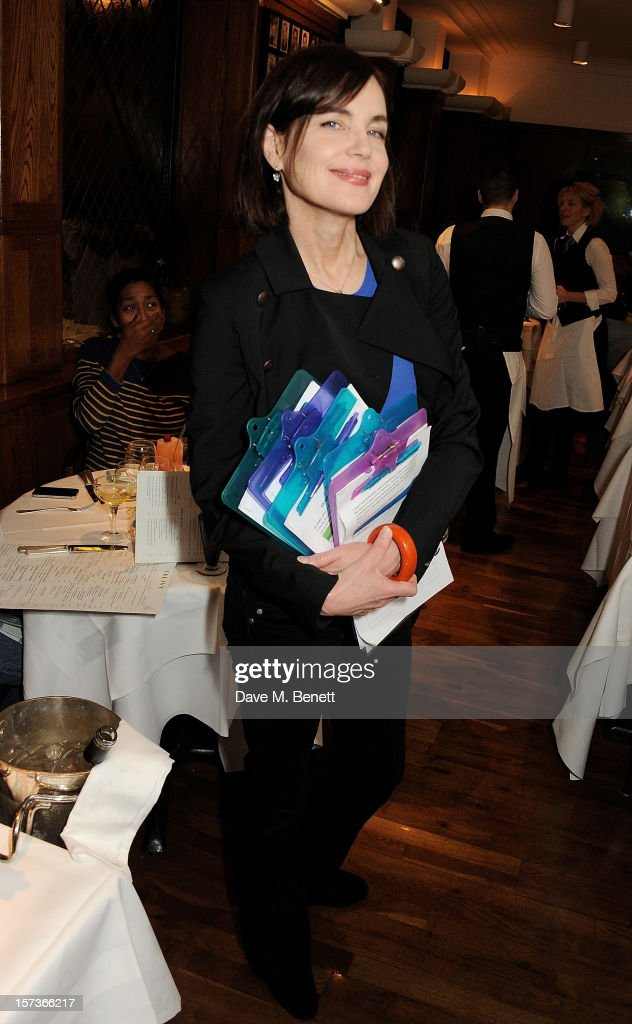 Actress <a gi-track='captionPersonalityLinkClicked' href=/galleries/search?phrase=Elizabeth+McGovern&family=editorial&specificpeople=734460 ng-click='$event.stopPropagation()'>Elizabeth McGovern</a>, working as a hostess, attends One Night Only at The Ivy, featuring 30 stage and screen actors working as staff during dinner at The Ivy, in aid of The Combined Theatrical Charities, on December 2, 2012 in London, England.