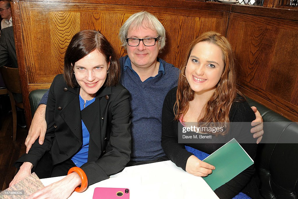 Actress Elizabeth McGovern, working as a hostess, husband Simon Curtis and daughter attend One Night Only at The Ivy, featuring 30 stage and screen actors working as staff during dinner at The Ivy, in aid of The Combined Theatrical Charities, on December 2, 2012 in London, England.