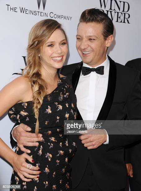Actress Elizabeth Olsen and actor Jeremy Renner attend the premiere of 'Wind River' at The Theatre at Ace Hotel on July 26 2017 in Los Angeles...