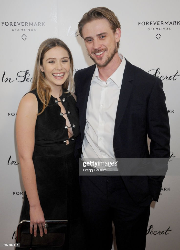 Actress Elizabeth Olsen and Boyd Holbrook arrive at the Los Angeles premiere of 'In Secret' at ArcLight Hollywood on February 6, 2014 in Hollywood, California.