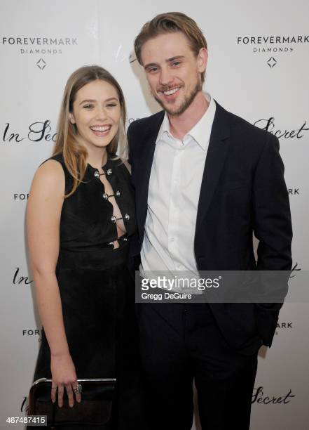 Actress Elizabeth Olsen and Boyd Holbrook arrive at the Los Angeles premiere of 'In Secret' at ArcLight Hollywood on February 6 2014 in Hollywood...