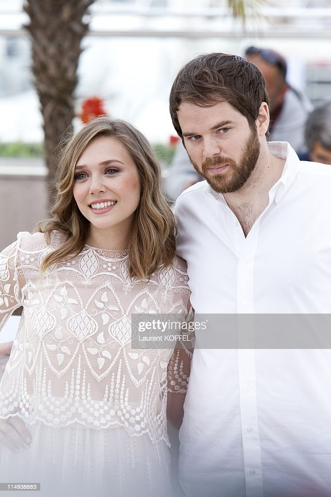Actress Elizabeth Olsen and director Sean Durkin attend the 'Martha Marcy May Marlene' photocall at the Palais des Festivals during 64th Cannes Film Festival on May 15, 2011 in Cannes, France.