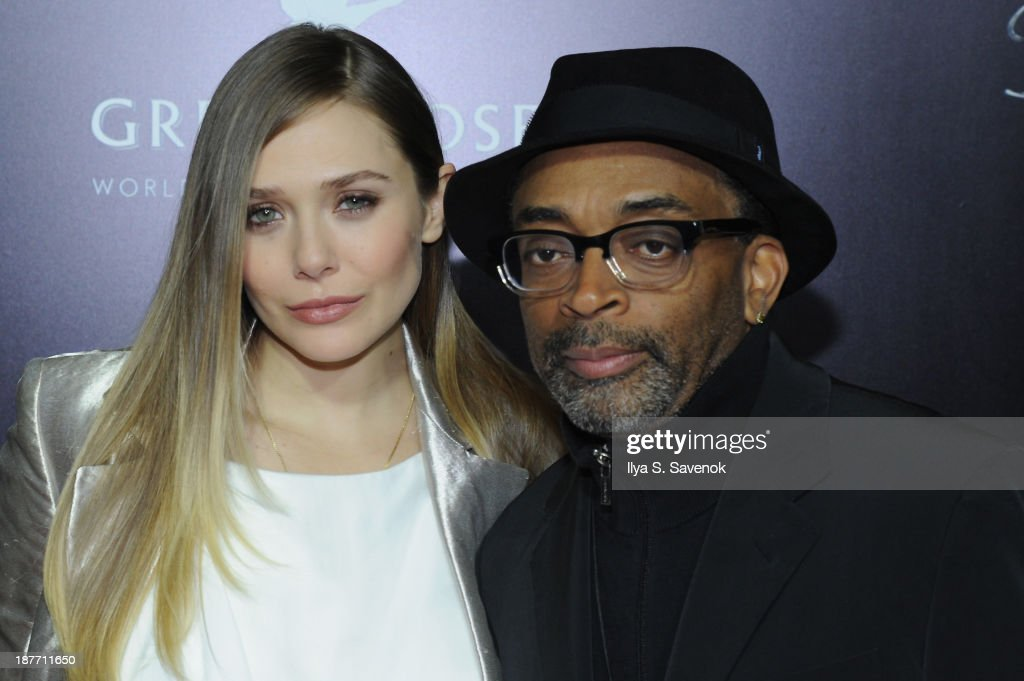 Actress Elizabeth Olsen and director Spike Lee attend the screening of 'Oldboy' hosted by FilmDistrict and Complex Media with the Cinema Society and Grey Goose at AMC Lincoln Square Theater on November 11, 2013 in New York City.