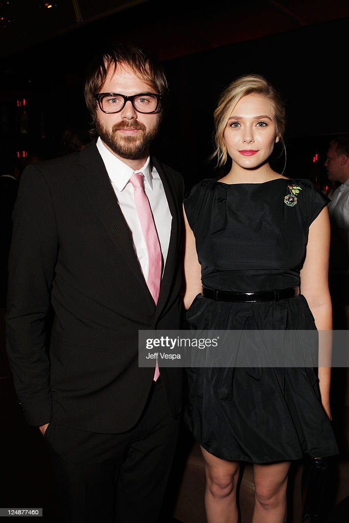 Actress <a gi-track='captionPersonalityLinkClicked' href=/galleries/search?phrase=Elizabeth+Olsen&family=editorial&specificpeople=5775031 ng-click='$event.stopPropagation()'>Elizabeth Olsen</a>, and filmmaker Sean Durkin attend Fox Searchlight Pictures, Belvedere Vodka And Vanity Fair Celebrate 'Martha Marcy May Marlene' And 'The Descendants' during TIFF at Thompson Hotel on September 10, 2011 in Toronto, Canada.