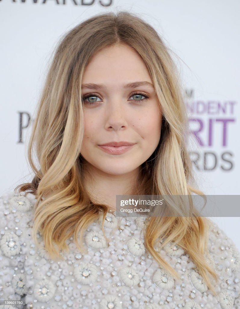 Actress <a gi-track='captionPersonalityLinkClicked' href=/galleries/search?phrase=Elizabeth+Olsen&family=editorial&specificpeople=5775031 ng-click='$event.stopPropagation()'>Elizabeth Olsen</a> arrives at the 2012 Film Independent Spirit Awards at Santa Monica Pier on February 25, 2012 in Santa Monica, California.