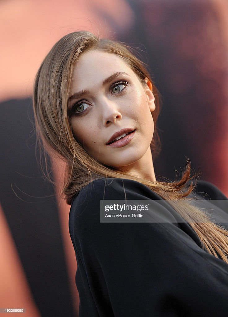 Actress <a gi-track='captionPersonalityLinkClicked' href=/galleries/search?phrase=Elizabeth+Olsen&family=editorial&specificpeople=5775031 ng-click='$event.stopPropagation()'>Elizabeth Olsen</a> arrives at the Los Angeles premiere of 'Godzilla' at Dolby Theatre on May 8, 2014 in Hollywood, California.