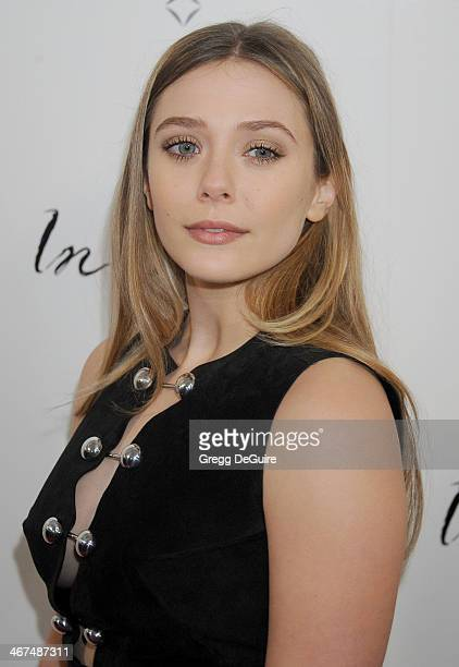 Actress Elizabeth Olsen arrives at the Los Angeles premiere of 'In Secret' at ArcLight Hollywood on February 6 2014 in Hollywood California