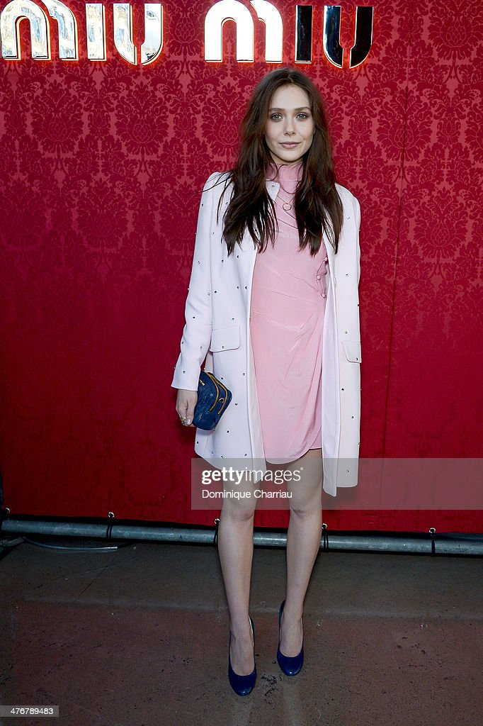 Actress <a gi-track='captionPersonalityLinkClicked' href=/galleries/search?phrase=Elizabeth+Olsen&family=editorial&specificpeople=5775031 ng-click='$event.stopPropagation()'>Elizabeth Olsen</a> attend the Miu Miu show as part of the Paris Fashion Week Womenswear Fall/Winter 2014-2015 on March 5, 2014 in Paris, France.