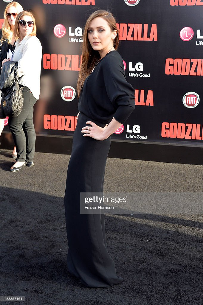 Actress <a gi-track='captionPersonalityLinkClicked' href=/galleries/search?phrase=Elizabeth+Olsen&family=editorial&specificpeople=5775031 ng-click='$event.stopPropagation()'>Elizabeth Olsen</a> attends the premiere of Warner Bros. Pictures and Legendary Pictures' 'Godzilla' at Dolby Theatre on May 8, 2014 in Hollywood, California.