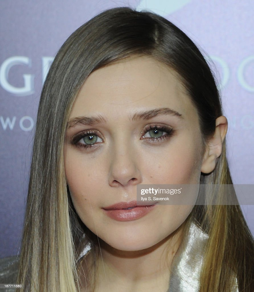 Actress Elizabeth Olsen attends the screening of 'Oldboy' hosted by FilmDistrict and Complex Media with the Cinema Society and Grey Goose at AMC Lincoln Square Theater on November 11, 2013 in New York City.