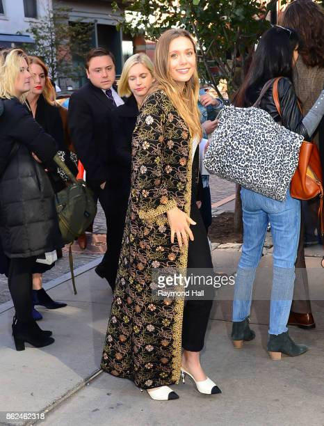 Actress Elizabeth Olsen is seen outsidre 'The Tribeca Chanel Womens Filmmarker Progam Lunchon' on October 17 2017 in New York City