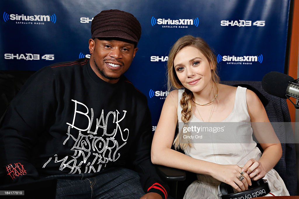 Actress <a gi-track='captionPersonalityLinkClicked' href=/galleries/search?phrase=Elizabeth+Olsen&family=editorial&specificpeople=5775031 ng-click='$event.stopPropagation()'>Elizabeth Olsen</a> (R) visits 'Sway in the Morning' with <a gi-track='captionPersonalityLinkClicked' href=/galleries/search?phrase=Sway+Calloway&family=editorial&specificpeople=214641 ng-click='$event.stopPropagation()'>Sway Calloway</a> (L) on Eminem's Shade 45 at the SiriusXM Studios on October 11, 2013 in New York City.