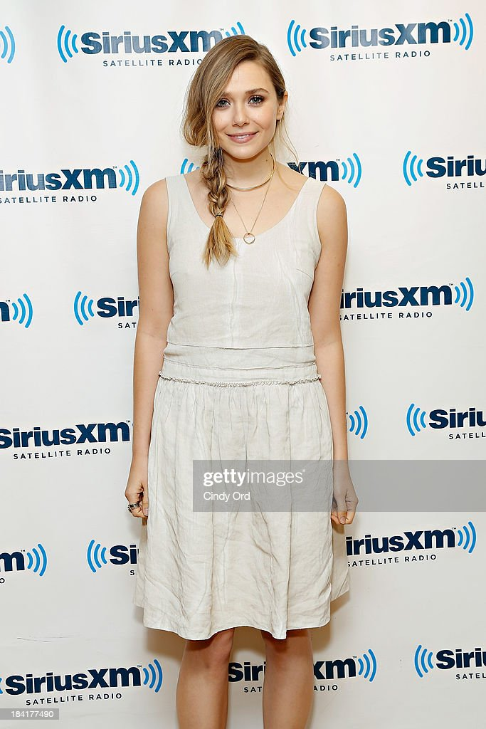Actress <a gi-track='captionPersonalityLinkClicked' href=/galleries/search?phrase=Elizabeth+Olsen&family=editorial&specificpeople=5775031 ng-click='$event.stopPropagation()'>Elizabeth Olsen</a> visits the SiriusXM Studios on October 11, 2013 in New York City.